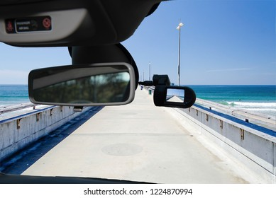 Looking through a dashcam car camera installed on a windshield with view of Venice Beach Pier, Los Angeles, California, USA