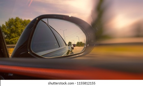 Looking through the mirror, street racers view, transportation backgrounds
