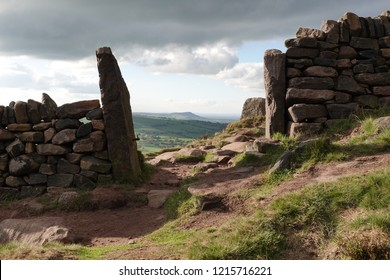 Looking through the old millstone grit gate posts on the Roaches, Blackshaw Moor Staffordshire, towards The Cloud which overlooks Congleton, Cheshire.