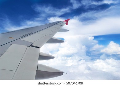 Looking through window aircraft during flight in wing with a nice blue sky.selective focus