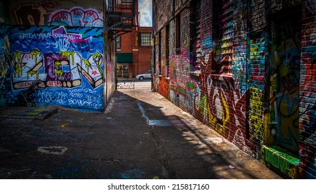 Looking toward Howard Street in the Graffiti Alley, Baltimore, Maryland.