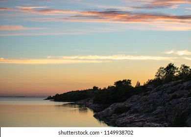 Looking towards the cloud-streaked pastel sky above the Baltic a few minutes after sunset, from Kökar, a municipality of the Åland Islands, Finland, at midsummer.