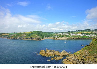 Looking towards Readymoney beach and St Margaret's castle across the mouth of the Fowey estuary from Polruan in summer, near Fowey, Cornwall, England, UK