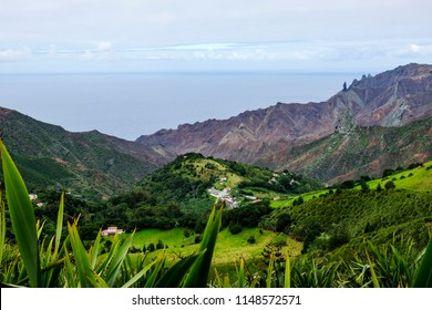 Looking towards Sandy Bay in St Helena and South Atlantic Ocean over volcanic features including geological pillar landmarks of Lot and Lots Wife on the right hand side
