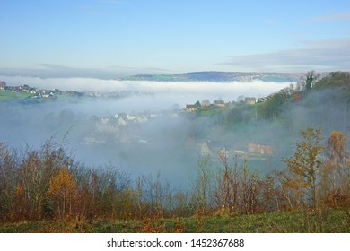 Looking towards Stroud in autumn and a foggy Stroud valley from Rodborough Common, The Cotswolds, Gloucestershire, United Kingdom