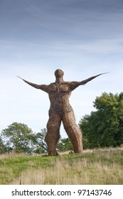 Looking towards wickerman willow sculpture at Archeolink in Aberdeenshire, Scotland, UK.