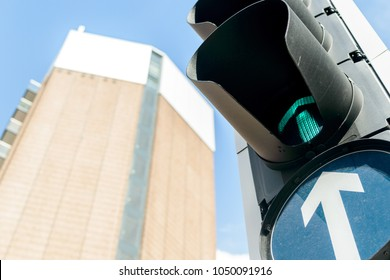Looking up at a Traffic Light with a High Rise Building in the background, shallow depth of field
