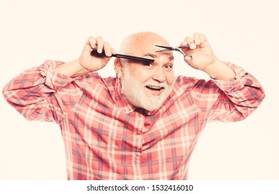 Looking trendy. barbershop concept. shaving accessories. unshaven old man has moustache and beard. mature bearded man isolated on white. shaving tool kit. cut and brush hair.