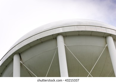 Looking up at the underside of a water tower.