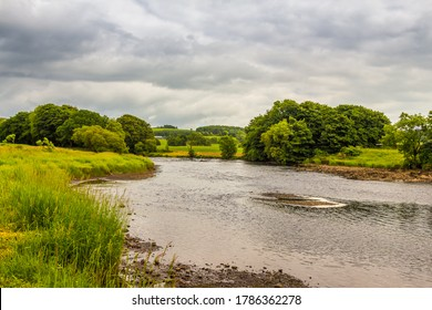 Looking upstream at the Graveyard Pool on the River Dee in low flow in Galloway, Scotland