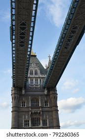 Looking upward from the lane to the pedestrian walkways of the Tower Bridge - London, Great Britain