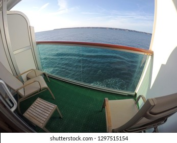 Looking at the view over the balcony of an ocean liner. Wide angle format with deep blue sky and ocean.
