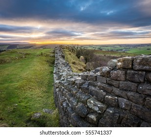 Looking west along Hadrian's Wall towards Cumbria at sunset.