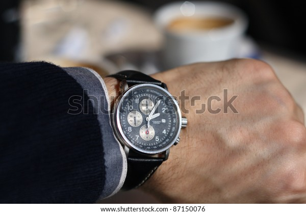 Looking at wrist watch