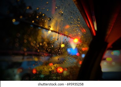 lookout of the car window with rain and traffic jam