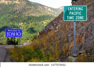 LOOKOUT PASS, IDAHO, USA - September 1, 2018: Entering Pacific Time Zone sign and Welcome to Idaho sign along Interstate 90 at the Idaho - Montana border