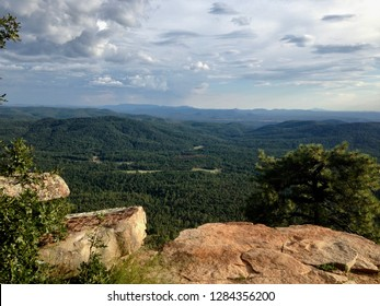 Lookout point at the Mogollon Rim outside of Payson Arizona with storm clouds & rain in the distance