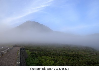 Lookout point on Shiretoko Pass with view of Mt. Rausu as evening fog rolls in