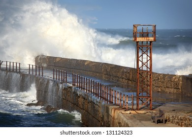 Lookout tower on a battered fishing pier on the eastern coast of South Africa