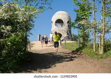 Lookout tower Ruzenka, HŘENSKO / CZECH REPUBLIC - May 6, 2018: New modern small public lookout tower Ruzenka with tourists near Hrensko and Decin, against blue sky in sunlight, Czech republic, Europe