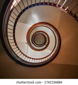 Lookup to Old renovated wooden high spiral staircase