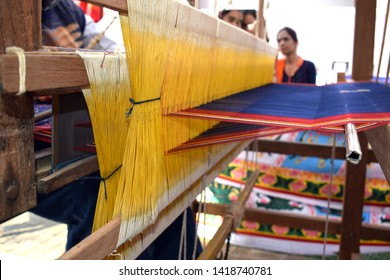 A loom is a device used to weave cloth and tapestry