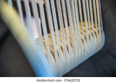 Loom threads being used