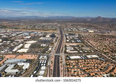The Loop 101 freeway winding through north Scottsdale, Arizona viewed from above