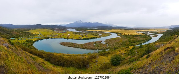 A loop of a river in Patagonia. Autumn landscape of Patagonia, Serrano River and Torres del Paine under clouds, Chile