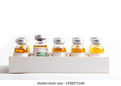 Looped. Flasks of vaccine for COVID-19 coronavirus in research lab. Vaccination, injection, clinical trial during pandemic.