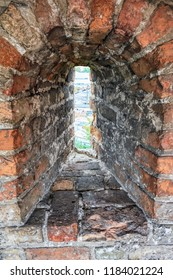 The loopholes in the wall medieval castle in the city of Lutsk (Ukraine).