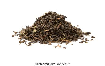 Loose dried darjeeling black tea leaves over white background
