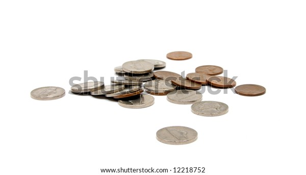 A loose pile of vintage American coins of various denominations. Old coins are becoming increasingly valuable due to their high content of silver and copper.