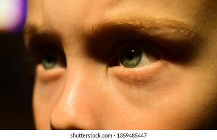 Loosing my eyesight. Small boy wear contact lens. Little boy with poor eyesight. Eye test at oculist. Oculist prescribe corrective lens. Childhood health. Health care is really right in the bulls eye.