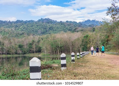 Lop Buri Thailand , December 29 , 2017 : happy family on the road, Mountains and lush tropical forests with lakes and beautiful sky