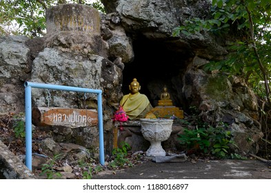 LOPBURI, THAILAND - JANUARY 8 : Cave in top of mountain for people travel visit and respect praying budda and angel statue at Wat Khao Wong Phra Chan on January 8, 2011 in Lopburi, Thailand