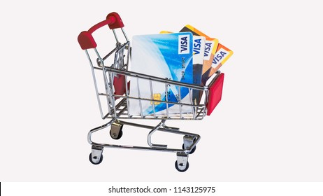 LOPBURI, THAILAND -JULY 27,2018:Four VISA Cards in  Small cart On a white background (isolated). Concept Shopping by credit card is comfortable.