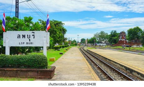 Lopburi, Thailand - June 30, 2018: Station sign of Lopburi Railway Station with ancient temple nearby