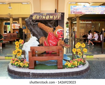 Lopburi, Thailand-February 25, 2019: A colorful statue of a Macaque Monkey (Macaca fascicularis) greets tourists at the train station in Lopburi and points them in the direction of the Monkey Temple