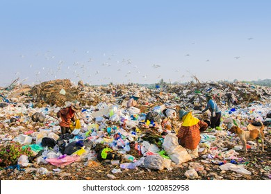 lopburi,thailand,24,february,2015,An unidentified lady known as a Garbage Dump Dweller. walks home from the landfill after collecting rubbish, waste, and debris in the city dump of lopburi,thailand,