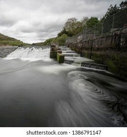 Lopwell Dam or weir. Lopwell Dam with fish ladder or salmon ladder is situated on the edge of Dartmoor on the River Tavy near Plymouth Devon in the rural South West of England. River Tamar tributary.