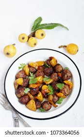 with a loquat dish. Meatballs with a loquat. or mini kebabs. medlar fruit with meatballs. Soft focus. Place for text. Copy Space