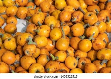 Loquat fruit or Japanese medlars background. Eriobotrya japonica