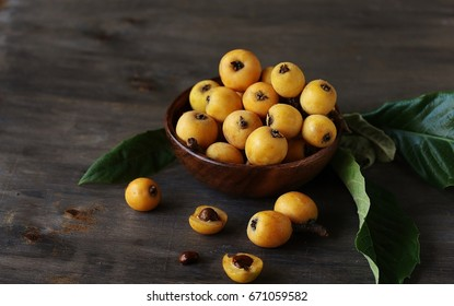 Loquat japanese in the bowl. Soft focus. Place for text. Copy Space