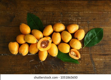 loquat on a wooden background