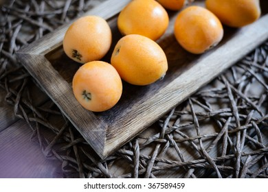 loquats on wooden tablet