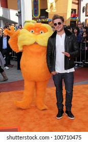 "Lorax and Zac Efron at the ""Dr. Seuss' The Lorax"" Premiere, Universal Studios, Universal City, CA 02-19-12"