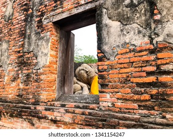 Lord buddha statue in thai art look pass from old windows