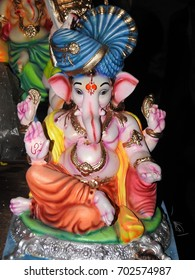 Lord Ganesha Statue, idol. Made of clay and soil, coated with ceramic colors, handmade artistic effects. He also known as Lord God Vinayaka and ganapathi.