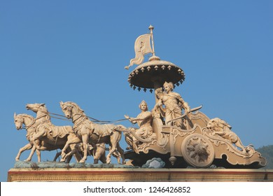 Lord Krishna and Arjuna on the chariot. Religious Indian sculpture. India, Rishikesh, December 2, 2018.
